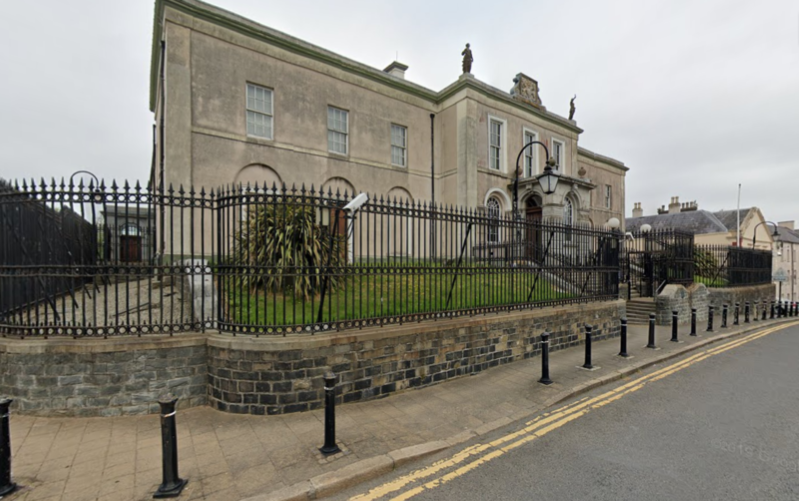 a building with a metal fence: Downpatrick Crown Court