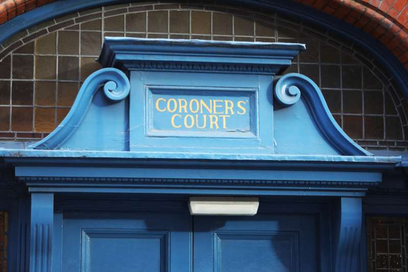 a blue clock sitting on the side of a building: File image of a coroner's court.