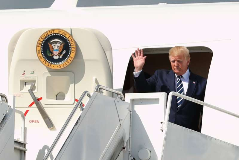 Donald Trump standing in front of a plane: US President Donald Trump waves as he arrived at Shannon Airport on Air Force Two for a visit to Ireland.
